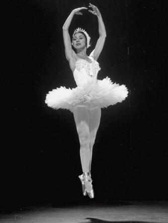 https://imgc.allpostersimages.com/img/posters/ballerina-margot-fonteyn-in-white-costume-leaping-into-the-air-while-dancing-alone-on-stage_u-L-P75V710.jpg?p=0