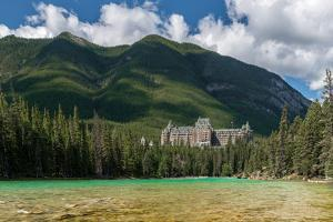 Banff Springs Hotel by Bow River in Banff National Park, Alberta, Canada
