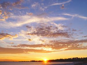A Sunset in a Beach in Pensacola, Florida, Usa. the Sunset Painting the Sky and Cloud Patterns, Wit by Banilar