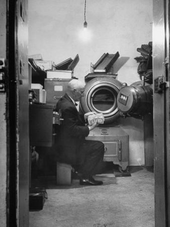Bank President Robert Allen Willis Checking Cash Funds in Main Vault