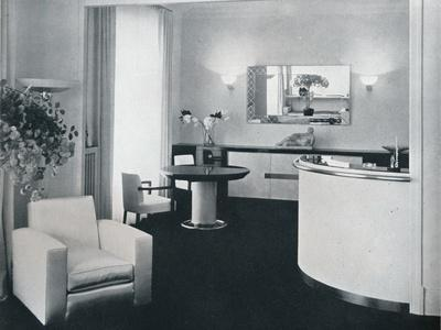 https://imgc.allpostersimages.com/img/posters/bar-corner-of-a-dining-room-designed-by-jacques-adnet-c1940_u-L-Q1EFBBY0.jpg?artPerspective=n