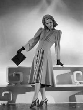 Barbara Stanwyck standing in Dress with Gloves and Heels Classic Portrait by E Bachrach