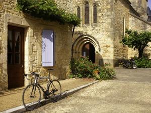 Racing Bike Parked in Street of Village of Daglan by Barbara Van Zanten