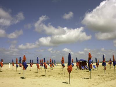 Red and Blue Beach Umbrellas on Deauville Beach by Barbara Van Zanten