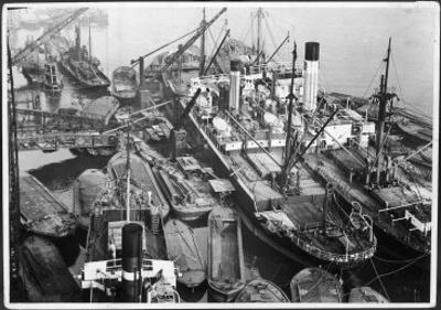 Barges Cranes and Tramp Steamers at the London Docks