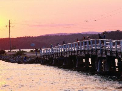 People Fishing from Wooden Bridge at Wallaga Lake Bermagui, New South Wales, Australia