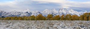 The Grand Teton Mountain Range Covered in Snow During the Fall by Barrett Hedges