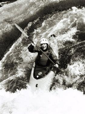 A Kayaker Careens over a Waterfall into the Swirling White Water Below by Barry Tessman