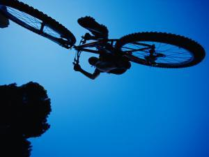 A Mountain Biker Careens in the Air and the Photographer Captures This Dynamic Image from Beneath by Barry Tessman