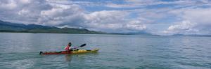 Kayaking Along the Yukon River by Barry Tessman