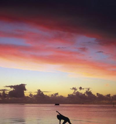 Woman Doing Yoga by Ocean at Sunset by Barry Winiker