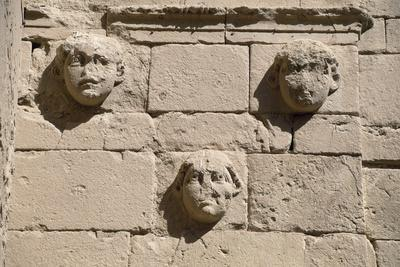 https://imgc.allpostersimages.com/img/posters/bas-reliefs-of-masks-in-temple-of-shamash-hatra_u-L-PPQYE00.jpg?artPerspective=n