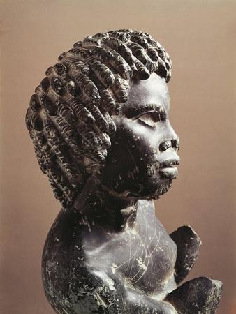 https://imgc.allpostersimages.com/img/posters/basalt-statue-of-young-man_u-L-POPTI20.jpg?p=0