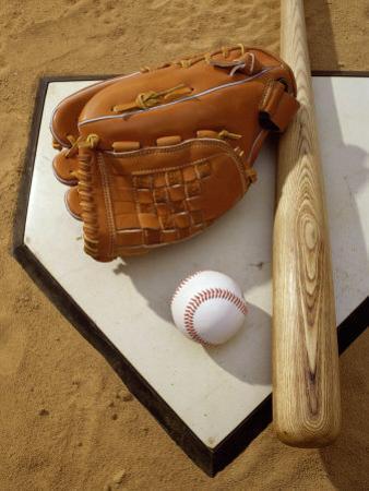 Baseball Bat with a Glove, and a Baseball on the Home Base