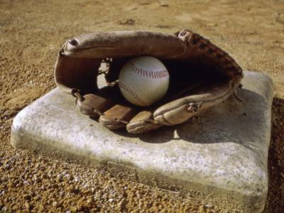 Baseball in a Baseball Glove on a Base