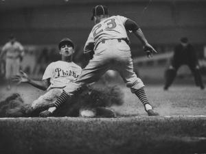 Baseball Player Chico Fernandez Sliding into Base