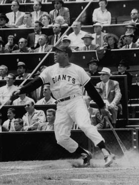Baseball Player Willie Mays Hitting a Ball