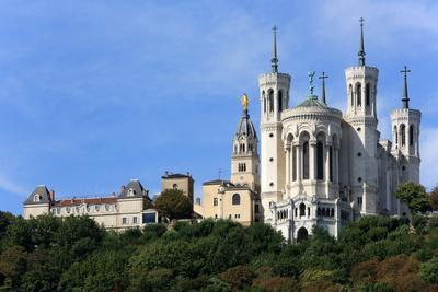 https://imgc.allpostersimages.com/img/posters/basilica-of-notre-dame-de-fourviere-with-its-four-crenellated-octagonal-towers-lyon-france_u-L-Q1GYGB30.jpg?artPerspective=n