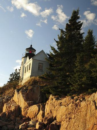 https://imgc.allpostersimages.com/img/posters/bass-harbor-head-lighthouse-in-late-afternoon-bass-harbor-mount-desert-island-maine-usa_u-L-PHAIX20.jpg?artPerspective=n