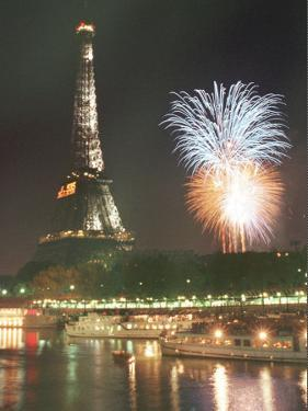Bastille Day Fireworks Explode Over the Seine River Next to the Eiffel Tower