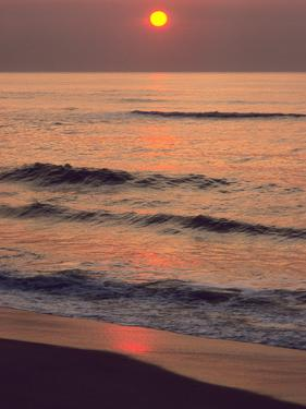 Sunrise over the Atlantic Ocean at Assateague Island by Bates Littlehales