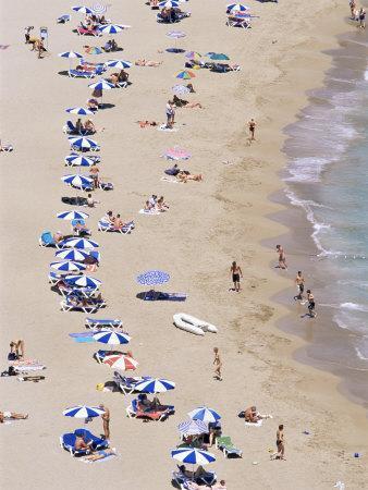 https://imgc.allpostersimages.com/img/posters/beach-cala-de-sant-vicent-ibiza-balearic-islands-spain-mediterranean_u-L-P1JQRE0.jpg?p=0