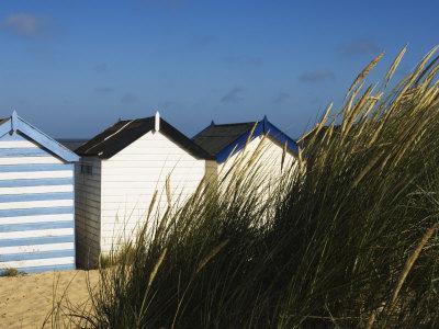 https://imgc.allpostersimages.com/img/posters/beach-huts-southwold-suffolk-england-united-kingdom_u-L-P1K8KQ0.jpg?artPerspective=n