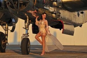 Beautiful 1940's Pin-Up Girl Standing with a B-25 Bomber