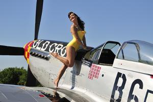 Beautiful 1940's Style Pin-Up Girl Posing with a P-51 Mustang