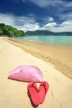https://imgc.allpostersimages.com/img/posters/beautiful-beach-landscape-with-hat-and-flip-flops-in-thailand_u-L-Q105A8A0.jpg?p=0