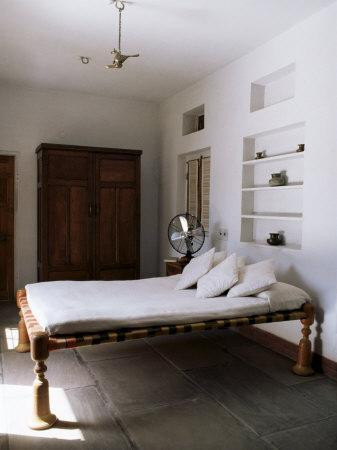 https://imgc.allpostersimages.com/img/posters/bedroom-with-traditional-low-slung-bed-or-charpoy-in-a-home-in-amber-near-jaipur-india_u-L-P1UJU70.jpg?p=0