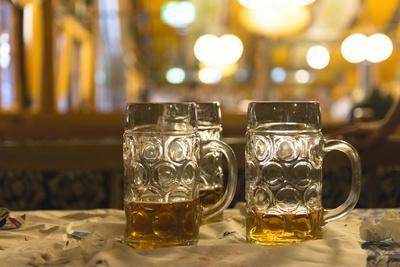 https://imgc.allpostersimages.com/img/posters/beer-mugs-in-a-beer-tent-oktoberfest_u-L-Q1EYDSJ0.jpg?artPerspective=n