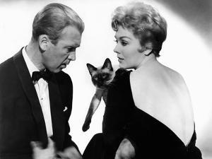 BELL, BOOK AND CANDLE, 1958 directed by RICHARD QUINE James Stewart and Kim Novak (b/w photo)