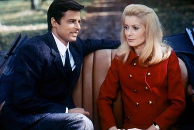 https://imgc.allpostersimages.com/img/posters/belle-by-jour-by-luis-bunuel-with-jean-sorel-and-catherine-deneuve-1967-costumes-par-yves-saint-l_u-L-Q1C3K5I0.jpg?artPerspective=n