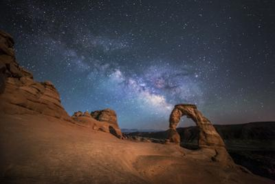 The Milky Way Shines over Delicate Arch at Arches National Park, Utah by Ben Coffman