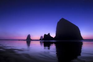 The Sun Sets Behind Haystack Rock at Cannon Beach, Oregon by Ben Coffman