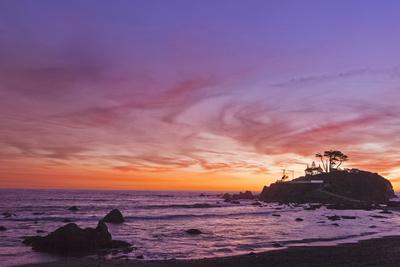 The Sun Sets Behind the Battery Point Lighthouse in Crescent City, California