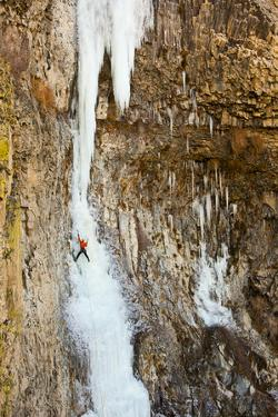 A Male Ice Climber on the First Pitch of Zenith Ice Route Near Banks Lake in Washington by Ben Herndon