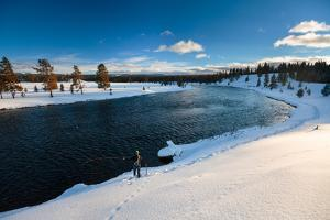 A Man Casts Along The Banks Of The Madison River Near West Yellowstone, Yellowstone National Park by Ben Herndon