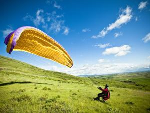 A Reverse Launch While Paragliding at Steptoe Butte on the Palouse in Eastern Washington. by Ben Herndon