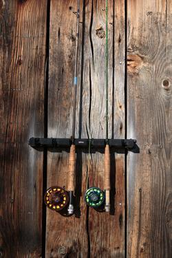 Fly Fishing Rods On The Side Of An Angler's Warming Hut by Ben Herndon