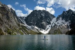 Man Paddle Boards Using Inflatable SUP, Colchuck Lake Alpine Lakes Wilderness Of The Cascade Range by Ben Herndon