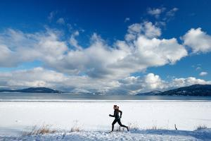 Noelle Zmuda Goes For Winter Run On The Pond Oreille Bay Trail, Sandpoint, Idaho. Lake Pend Oreille by Ben Herndon
