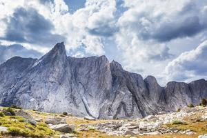 Two Hikers are Dwarfed by the 12,173 Foot Ambush Peak in the Wind River Range by Ben Herndon