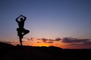 A Climber Practices Yoga Atop a Granite Block as the Sun Sets by Ben Horton