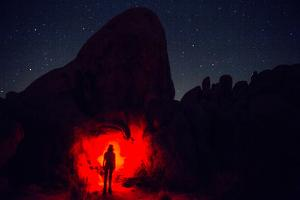 A Hiker with a Red Headlight Makes for an Eerie Photo in Joshua Tree National Park by Ben Horton