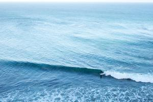A Lone Surfer Rides a Pacific Wave by Ben Horton
