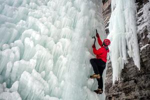 A man climbs on an ice wall, called The Fang, in Vail, Colorado. by Ben Horton