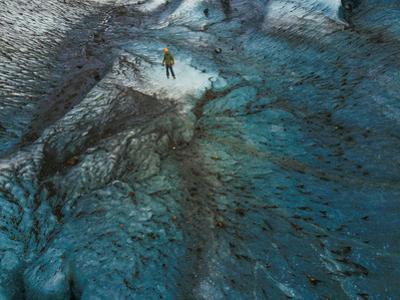 A man walking on the Vatnajokull glacier. by Ben Horton