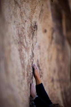 A Rock Climber's Hands Grip the Granite High Above the Ground by Ben Horton